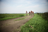the neutralised peloton rides over a 'gravel section'<br /> <br /> 90th Schaal Sels 2015