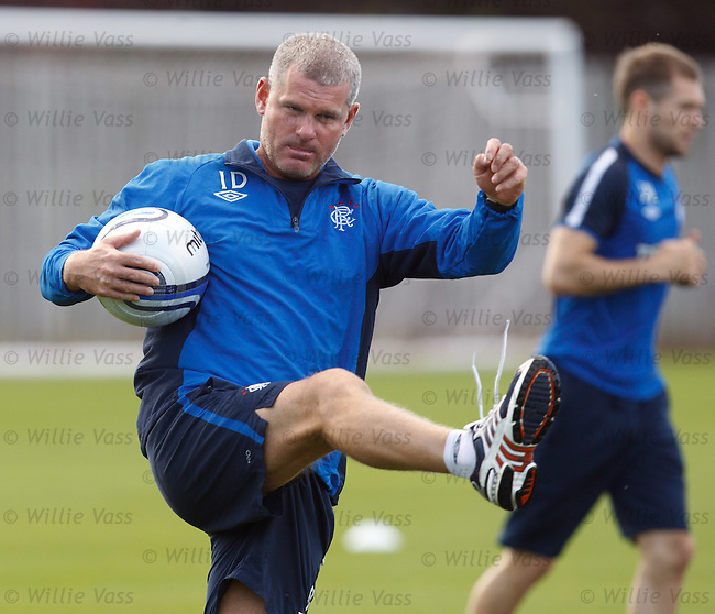 Rangers coach Ian Durrant boots the balls across the field