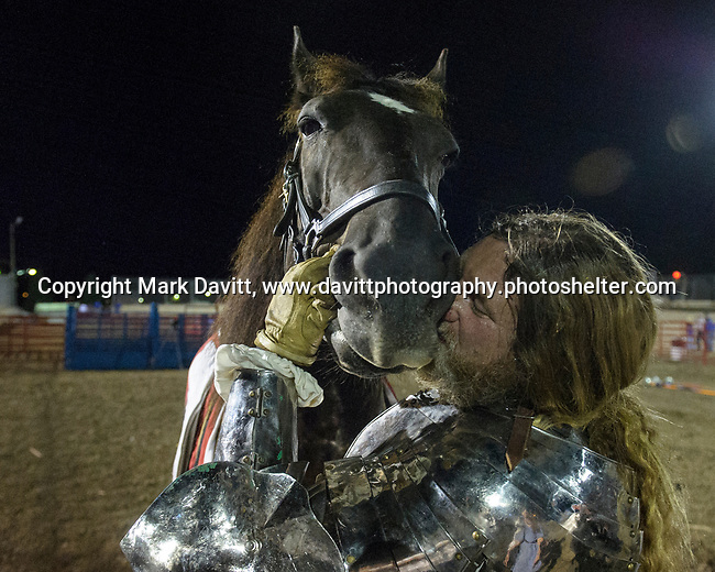 The Warren County Fair grandstand got very medieval July 27 when the nationally-known Knights of Valour performed a jousting tournament for a nearly packed house. The knight appreciated and thank their horses for the hard work. A trainer for the horses travels everywhere with the group.