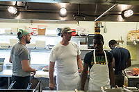 Josh Aronie, 47, (in white with hat) is executive chef at Home Port, a restaurant in Chilmark/Menemsha, Martha's Vineyard, Massachusetts, USA.  Home Port did not receive any H2B temporary foreign worker visas this year and has had difficulty filling all positions in the kitchen. On the day of this picture, one scheduled worker did not come to work and the restaurant could not find a backup to fill in. The restaurant has also quit serving lunch as a result of difficulty in finding workers.