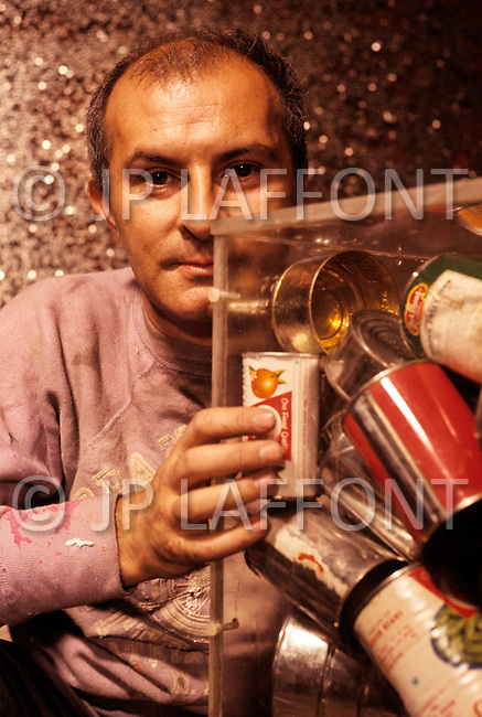 "New York City, New York - Circa1967. In his Hotel Chelsea studio, Arman is working on a new art piece. Arman (November 17, 1928 - October 22, 2005) was a French-born artist, from the Nice Art School and is best known for his ""accumulations"" and deconstruction/decomposition of objects."