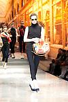 March 29, 2012, Tokyo Japan - A model walks down the catwalk and carries a bag of Yuki Torii's design. Run way of Yuki Torii International.