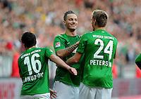 FUSSBALL   1. BUNDESLIGA   SAISON 2012/2013   4. SPIELTAG SV Werder Bremen - VfB Stuttgart                         23.09.2012        Zlatko Junuzovic, Marko Arnautovic und Nils Petersen (v.l., alle SV Werder Bremen) jubeln nach dem 2:0