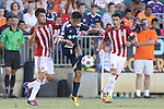 14 June 2014: Carolina's Cesar Elizondo (CRC) (center) is defended by Chivas USA's Carlos Alvarez (left) and Marco Delgado (right). The Carolina RailHawks of the North American Soccer League played Chivas USA of Major League Soccer at WakeMed Stadium in Cary, North Carolina in the fourth round of the 2014 Lamar Hunt U.S. Open Cup soccer tournament. The RailHawks advanced by winning a penalty kick shootout 3-2 after the game had ended in a 1-1 tie after overtime.