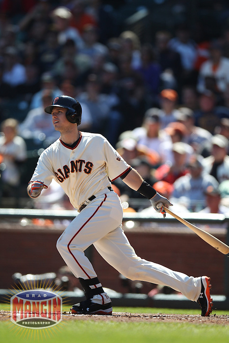 SAN FRANCISCO - SEPTEMBER 20:  Buster Posey of the San Francisco Giants bats during the game against the Colorado Rockies at AT&T Park on September 20, 2012 in San Francisco, California. (Photo by Brad Mangin)