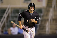 Jake Burger (31) of the Kannapolis Intimidators is all smiles as he returns to the dugout after scoring the go-ahead run against the Greensboro Grasshoppers at Kannapolis Intimidators Stadium on September 8, 2017 in Kannapolis, North Carolina.  The Intimidators defeated the Grasshoppers to sweep the South Atlantic League Northern Division playoffs in two games.  (Brian Westerholt/Four Seam Images)