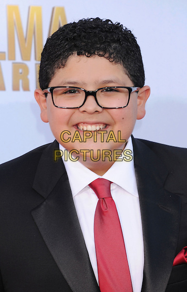 Rico Rodriguez.2012 NCLR ALMA Awards - arrivals, held at The Pasadena Civic Auditorium, Pasadena, California USA..16th September 2012.headshot portrait black suit red tie white shirt glasses  .CAP/ROT/TM.© TM/Roth/Capital Pictures