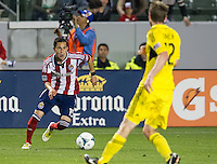 CARSON, CA - March 2, 2013: Chivas midfielder Eric Avila (15) during the Chivas USA vs Columbus Crew match at the Home Depot Center in Carson, California. Final score, Chivas USA 0, Columbus Crew 3.