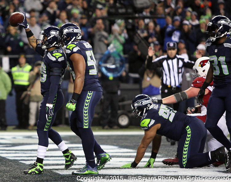 Seattle Seahawks  linebacker K. J. Wright celebrates with free safety Earl Thomas (29) after intercepting a pass intended for Arizona Cardinals wide receiver Michael Floyd(15) one the one yard line at CenturyLink Field in Seattle, Washington on November 15, 2015. The Cardinals beat the Seahawks 39-32.   ©2015. Jim Bryant photo. All Rights Reserved.