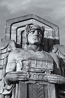 The Guardians of Traffic which stand on the ends of the Hope Memorial Bridge (formerly the Lorain-Carnegie Bridge) symbolize progress in transportation.  There are eight Guardians, two on each side of the double-sided sandstone pylons which flank each side of the ends of the bridge.  Each Guardian holds a different vehicle in his hand, representing the history of ground transportation.