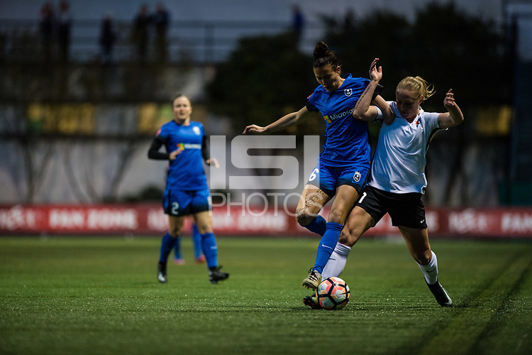 Seattle, WA - April 15th, 2017: Leah Galton and Carson Pickett during a regular season National Women's Soccer League (NWSL) match between the Seattle Reign FC and Sky Blue FC at Memorial Stadium.