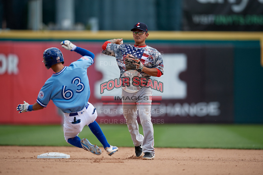 Pawtucket Red Sox shortstop Tzu-Wei Lin (5) throws to first base as Kevin Vicuna (63) slides in during an International League game against the Buffalo Bisons on August 25, 2019 at Sahlen Field in Buffalo, New York.  Buffalo defeated Pawtucket 5-4 in 11 innings.  (Mike Janes/Four Seam Images)