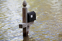 The Sandquist's mailbox stands in nearly four feet of Mississippi River floodwater in the Red Star District of Cape Girardeau, MO, on Thursday, April 28, 2011.