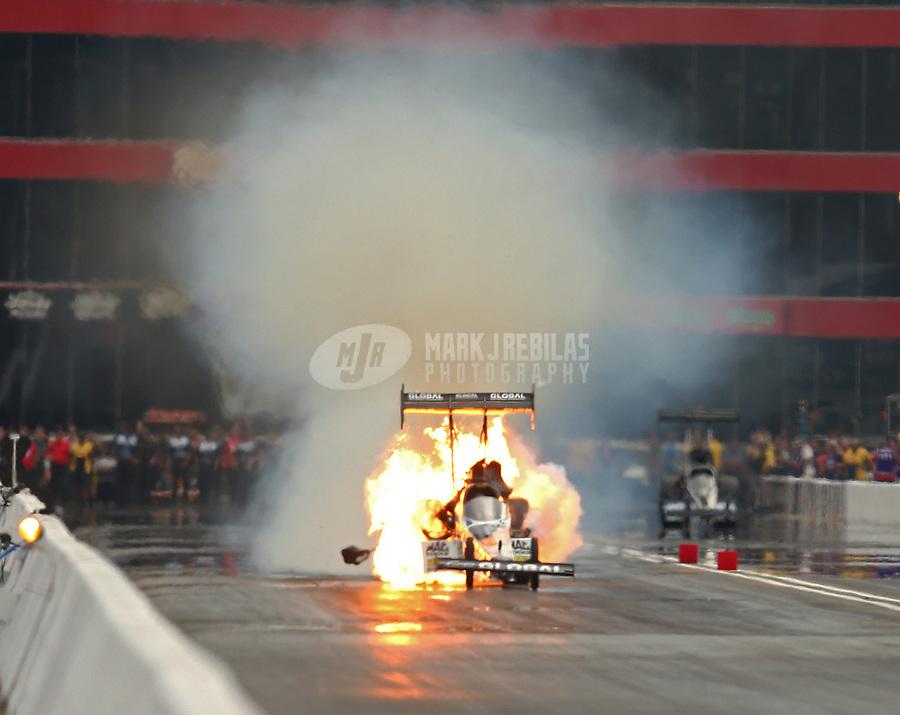 Jun 17, 2017; Bristol, TN, USA; NHRA top fuel driver Shawn Langdon explodes an engine on fire during qualifying for the Thunder Valley Nationals at Bristol Dragway. Mandatory Credit: Mark J. Rebilas-USA TODAY Sports