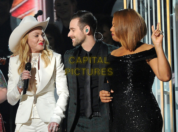 LOS ANGELES, CA - JANUARY 26 : (L-R) Madonna, Ryan Lewis and Queen Latifah perform onstage at The 56th Annual GRAMMY Awards at Staples Center on January 26, 2014 in Los Angeles, California.<br /> CAP/MPI/PG<br /> &copy;PGFMicelotta/MediaPunch/Capital Pictures
