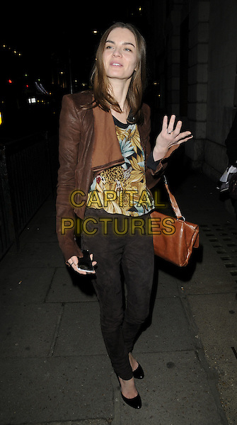 ANOUCK LEPERE.Charity Screening of 'Nowhere Boy' held at BAFTA Piccadilly, London, England. .November 26th, 2009 .full length black jeans denim brown jacket anouk satchel hand leopard print top.CAP/CAN.©Can Nguyen/Capital Pictures.