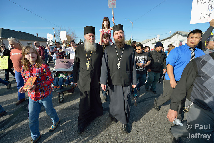 Priest Jesse Philo (left) and Archpriest Seraphim Bell of the Saint John (Russian) Orthodox Church in Kennewick, Washington, participate in a February 14 2015 march in Pasco, Washington, that demanded justice for the killing of Antonio Zambrano Montes by three Pasco police officers on February 10.