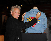 HOLLYWOOD FL - JUNE : Don Felder The Eagles' former lead guitarist donates his Gibson 100th Anniversary celebration denim jacket that he wore in all advertisements in 1994 with fellow band member Joe Walsh to Hard Rock International at  Hard Rock Cafe held at the Seminole Hard Rock hotel & Casino on June 7, 2012 in Hollywood, Florida. © mpi04 / Media Punch Inc.