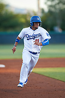 AZL Dodgers Mota Luis Carlos Diaz (11) runs to third base during an Arizona League game against the AZL Rangers at Camelback Ranch on June 18, 2019 in Glendale, Arizona. AZL Dodgers Mota defeated AZL Rangers 13-4. (Zachary Lucy/Four Seam Images)