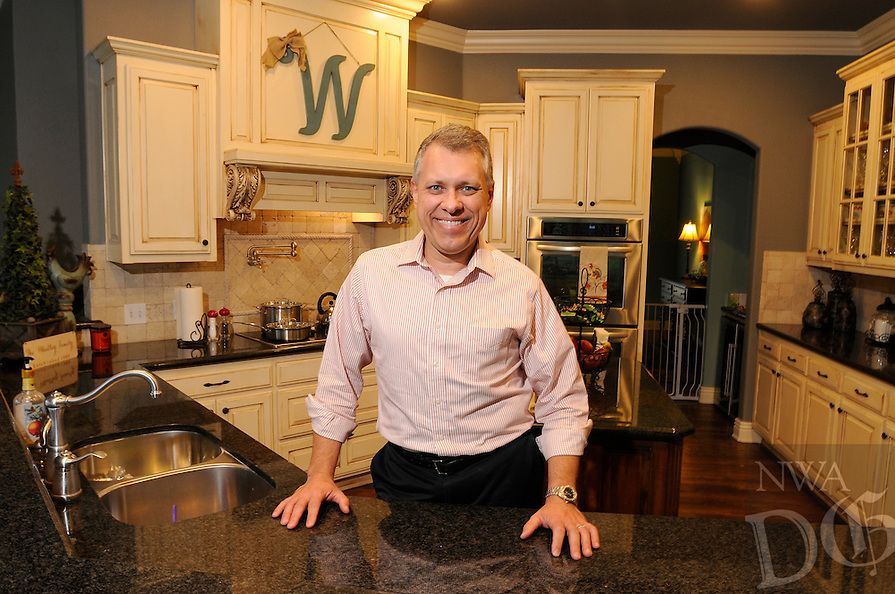 NWA Democrat-Gazette/ J.T. WAMPLER -- Todd Whatley. in his favorite spot, his kitchen Tuesday April 14, 2015.