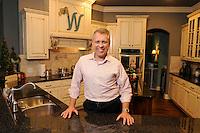 NWA Democrat-Gazette/ J.T. WAMPLER -- Todd Whatley. in his favorite spot, his kitchen Tuesday April 14, 2015.