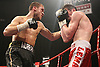 John Murray (Manchester, black shorts) defeats Scott Lawton (Stoke, red shorts) in a Lightweight contest for the British Title at the Robin Park Centre, Wigan, promoted by Hennessy sports - 13/06/09 - MANDATORY CREDIT: Chris Royle