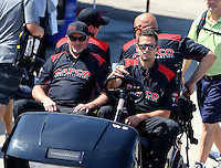 Apr 25, 2015; Baytown, TX, USA; Crew members for NHRA top fuel driver Steve Torrence riding in a golf cart during qualifying for the Spring Nationals at Royal Purple Raceway. Mandatory Credit: Mark J. Rebilas-