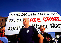 "William Donohue, Executive Director of the Catholic League joins other organizations and religious leaders in condemning the Brooklyn Museum and the controversial ""Sensation"" Show on October 2, 1999. Over 9000 people visited the show on the opening day despite admonitions from Mayor Rudy Giuliani and religious leaders. (© Richard B. Levine)"