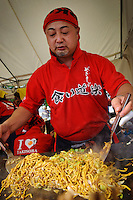 "A yakisoba stall, B1 Grand Prix, Yokote, Akita Pref, Japan, September 19 2009. The B1 Grand Prix is a competition for inexpensive and tasty regional dishes from around Japan. The B stands for ""b-class gourmet"". In 2009 it was held in the northern Japan city of Yokote."