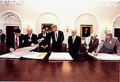 """Israeli and Palestinian leaders sign the maps that were part of the """"Oslo 2"""" agreement on September 28, 1995.  This part of the signing took place in the Cabinet Room at the White House. (L-R) Unidentified Israeli; Israeli Prime Minister Yitzak Rabin; Egyptian President Hosni Mubarak; U.S. President Bill Clinton; King Hussein of Jordan; Palestinian Authority Chairman Yassir Arafat; and unidentified Palestinian..Mandatory Credit: Barbara Kinney - White House via CNP"""