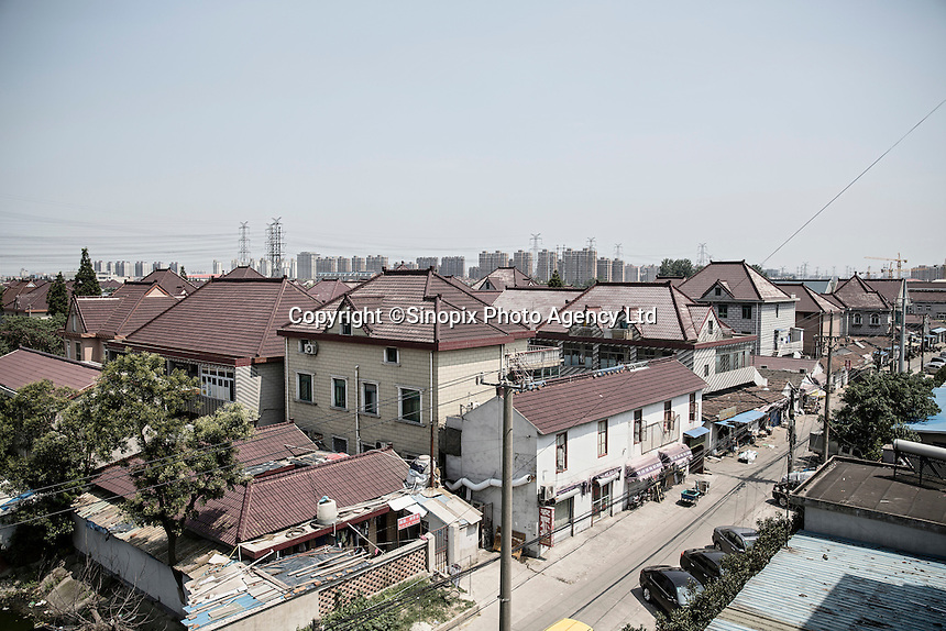 A view of Xingxing village on the outskirts of Shanghai,  China on 14 August 2015.  As China's sputtering economy has beginning to affect employment, many migrants who used to live in the village to work on Shanghai's numerous construction sites and factories are beginning to thin out.