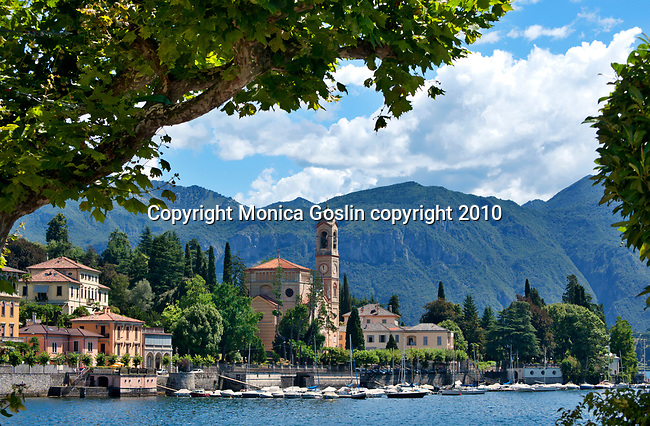 Panorama view framed with trees of Tremezzo, a town on Lake Como, Italy