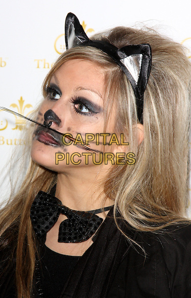 NIKKI GRAHAME .Bloodlust Ball hosted by the Button Club at One Marylebone Road, London, England.  .October 25th 2008.headshot portrait  black cat costume dress-up ears whiskers bow tie.CAP/ROS.©Steve Ross/Capital Pictures