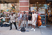 Street musicians sing doo-wop songs on Bleecker Street in Greenwich Village in New York as they entertain the passing tourists and annoy the heck out of the residents, seen on Saturday, July 21, 2012. (© Richard B. Levine)