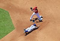 Apr. 12, 2009; Phoenix, AZ, USA; Los Angeles Dodgers base runner Juan Pierre safely steals second base ahead of the throw to Arizona Diamondbacks shortstop Stephen Drew at Chase Field. Mandatory Credit: Mark J. Rebilas-