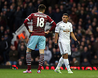 Sunday 07 December 2014<br /> Pictured: Jefferson Montero of Swansea (R) has a go at Carl Jenkinson of West Ham (L) for pulling his shirt<br /> Re: Premier League West Ham United v Swansea City FC at Boleyn Ground, London, UK.