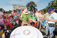 2014 World Championship Snail Racing in Congham (Norfolk)<br /> Picture description:<br /> &quot;Ready, Steady...SLOW&quot; and they are off  at the amazing speed of 0.0005 mph on the 13&quot; track.<br /> General infos:For more than 25 years the World Snail Racing Championships have been held at Congham, near King's Lynn, in Norfolk.Before snails can enter a race a sticker with a number must be put on so they can be identified. The snails race from the centre of a circle to the outside. The circle has a radius of 13 inches. The snails are put in the middle and pointed in the right direction.The  Snail Master Neil starts the races. He shouts: &quot;Ready, steady, SLOW!&quot; And off dash the snails! The Snail Master keeps the course well-watered as snails like damp conditions.Races are held on a table covered with a white cloth. Machine a circle, with braid in the middle, and then machine a similar circle 13 inches away.Owners do dress up. The World record stands at 2 minutes over the 13 inches. It was set up in 1995 by a snail called Archie. The record can only be challenged at the World Championships at Congham.Giant foreign snails are not allowedOften owners like to give their snails names like Speedy or Schumacher!<br /> Picture by Marcello Pozzetti &copy; IPS PHOTO AGENCY<br /> Cavell Barn<br /> The Common<br /> Swardeston<br /> Norwich<br /> Norfolk<br /> NR14 8DZ<br /> T 01508 571 480<br /> M 07973308835