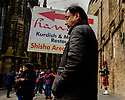 Edinburgh, UK. 15.04.2017. A man holds a restaurant sign, next to a busking piper, on the Royal Mile. Photograph © Jane Hobson.