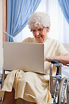 USA, Illinois, Metamora, Senior woman on wheelchair using laptop