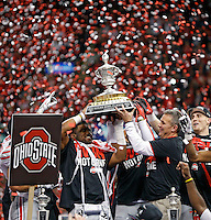 Ohio State Buckeyes running back Ezekiel Elliott (15) and Ohio State Buckeyes head coach Urban Meyer hold up the Sugar Bowl trophy after beating Alabama Crimson Tide in the Allstate Sugar Bowl college football Playoff Semifinal game at the Mercedes-Benz Superdome in New Orleans, Louisiana on January 1, 2015.  (Dispatch photo by Kyle Robertson)