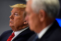 United States President Donald J. Trump listens during a teleconference with governors at the Federal Emergency Management Agency headquarters, Thursday, March 19, 2020, in Washington, DC US Vice President Mike Pence is at right.<br /> Credit: Evan Vucci / Pool via CNP/AdMedia