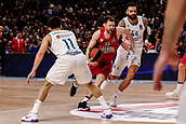 9th February 2018, Wiznik Centre, Madrid, Spain; Euroleague Basketball, Real Madrid versus Olympiacos Piraeus; Janis Strelnieks (OLYMPIACOS BC) brings the ball past  Facundo Campazzo (Real Madrid Baloncesto)