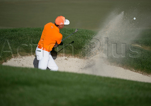 28.02.2016. Palm Beach, Florida, USA.  Rickie Fowler hits out of the bunker at the 18th hole during the final round of the Honda Classic at the PGA National Resort & Spa in Palm Beach Gardens, FL.