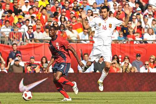 04.06.2011. United States midfielder Maurice Edu (7) manages to get past Spain midfielder Sergio Busquets (16)  with the ball during the USA game against Spain at Gillette Stadium in Foxborough, MA