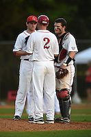 Ball State Cardinals head coach Rich Maloney talks with pitcher Trevor Simon (23) and catcher Jarett Rindfleisch (25) during a game against the Maine Black Bears on March 3, 2015 at North Charlotte Regional Park in Port Charlotte, Florida.  Ball State defeated Maine 8-7.  (Mike Janes/Four Seam Images)