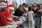 NHP Trooper Dan Lopez shops with a local student at the 11th annual Holiday with a Hero at Walmart in Carson City, Nev., on Wednesday, Dec. 16, 2015. <br /> Photo by Cathleen Allison