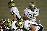 Torrance, CA 11/05/10 - Brock Dale (Peninsula #7) and Logan Okuda (Peninsula #25) in action during the Peninsula vs West varsity football game played at West Torrance high school.