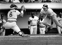 Boston Red Sox Bill Buckner tries to score on Oakland A's catcher Mickey Tettleton (1985 photo by Ron Riesterer)
