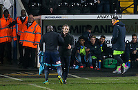Wycombe Wanderers Manager Gareth Ainsworth as Adebayo Akinfenwa of Wycombe Wanderers passes him after being sent off during the Sky Bet League 2 match between Notts County and Wycombe Wanderers at Meadow Lane, Nottingham, England on 10 December 2016. Photo by Andy Rowland.