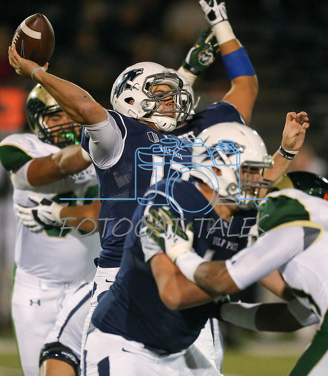 Nevada quarterback Cody Fajardo (17) passes against Colorado State during the first half of an NCAA college football game in Reno, Nev., on Saturday, Oct. 11, 2014. Colorado State won 31-24. (AP Photo/Cathleen Allison)